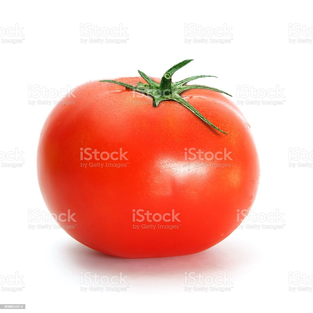 One tomato with drops on white stock photo