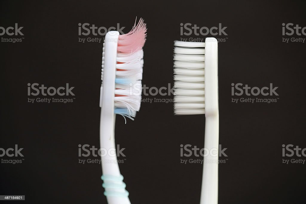 One toothbrush before & after. stock photo