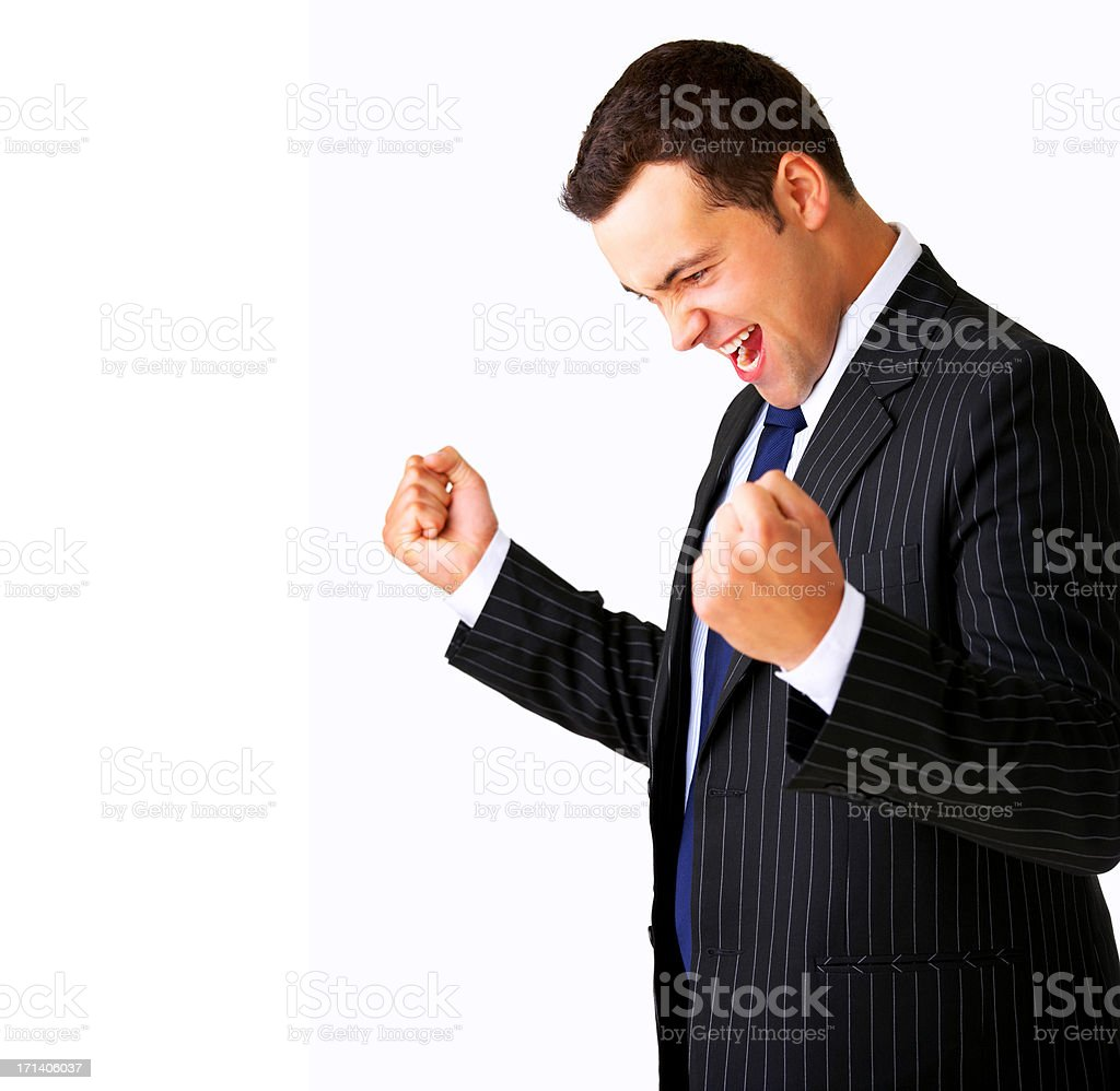One very happy energetic businessman with his arms raised royalty-free stock photo