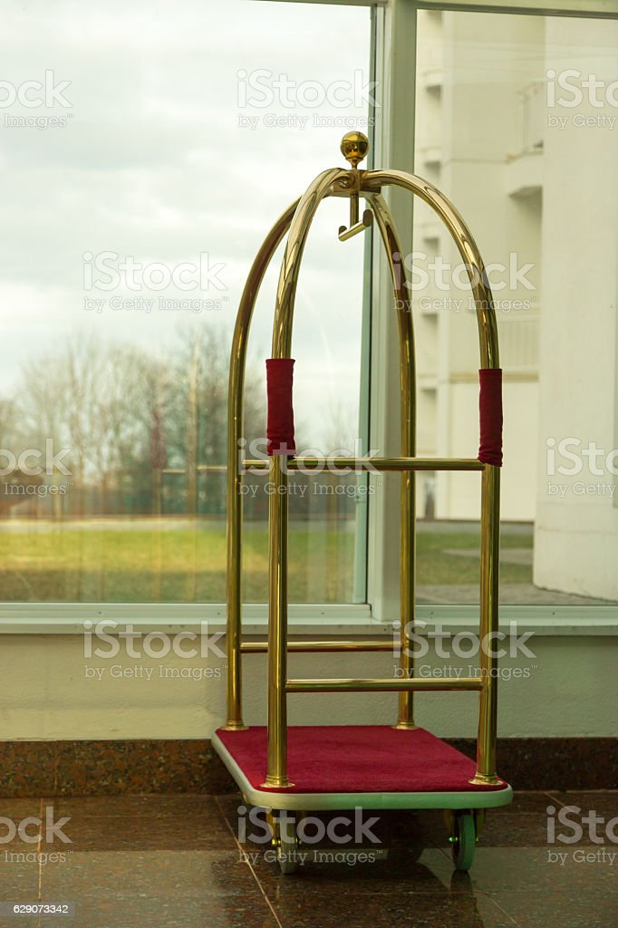 One vintage hotel baggage carts with door on background stock photo