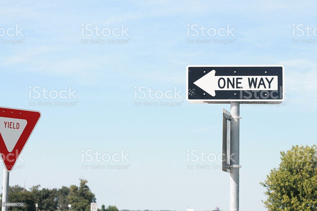 One Way and Yield Sign stock photo