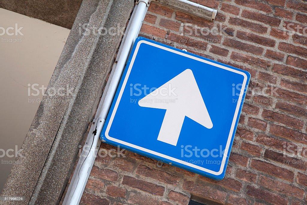 One Way Arrow Street Sign stock photo