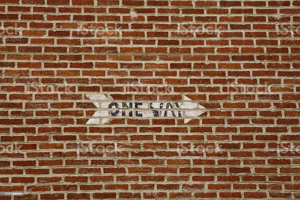 one way on brick wall royalty-free stock photo