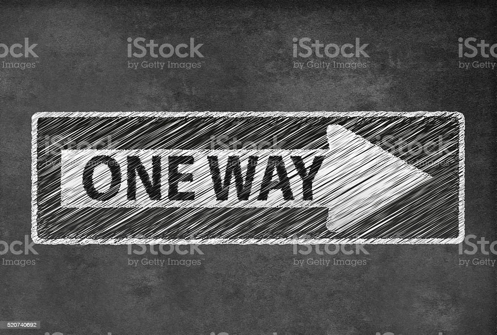 One Way Road Traffic Sign on a blackboard stock photo