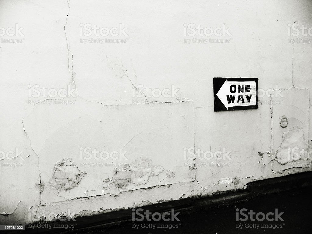 One Way Sign on Old Decrepit Wall royalty-free stock photo