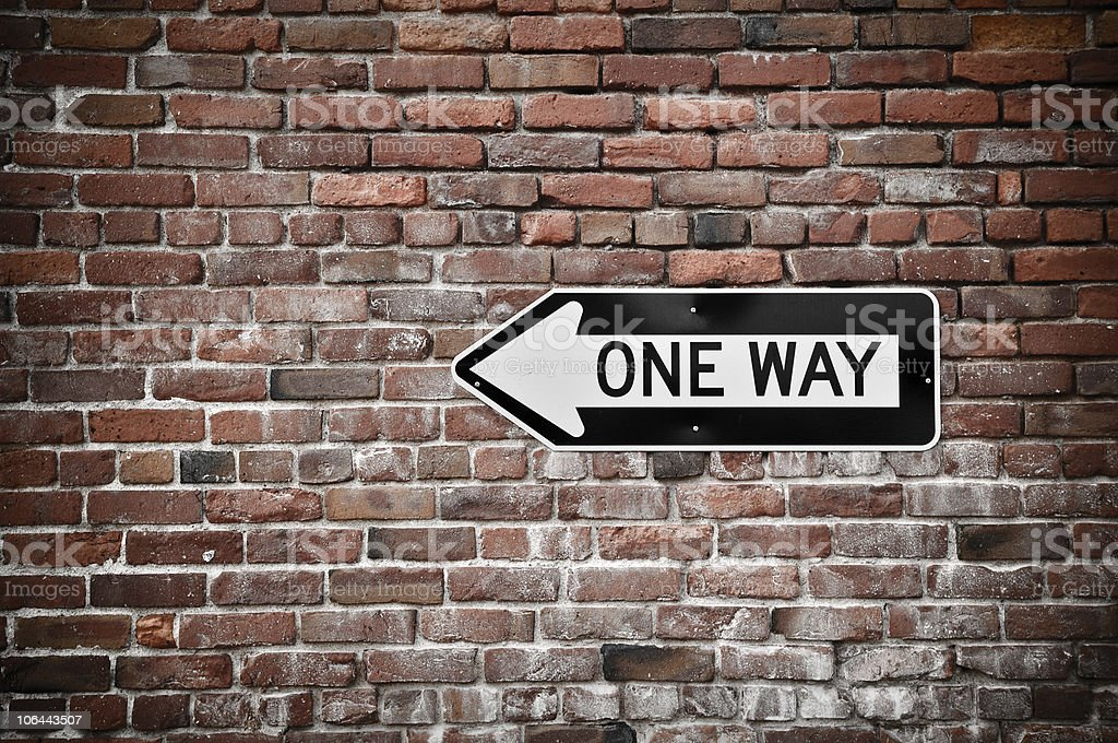One Way Sign with Grunge Brick Wall Background stock photo