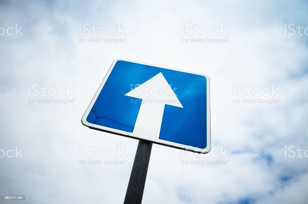 One way street, blue road sign over sky background stock photo