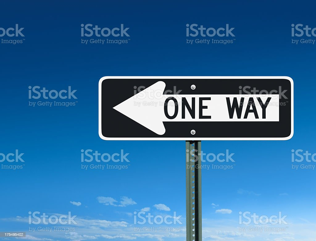 One Way Street Sign Post Pointing Leftward on Blue Sky royalty-free stock photo
