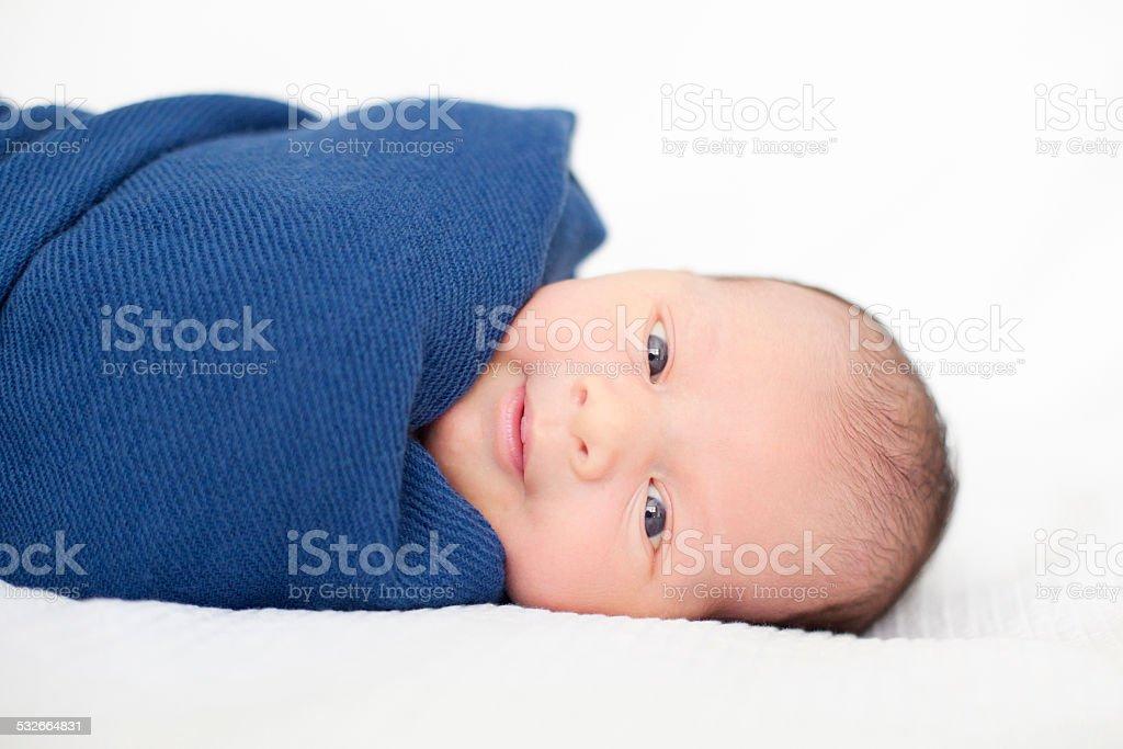One week old baby boy stock photo