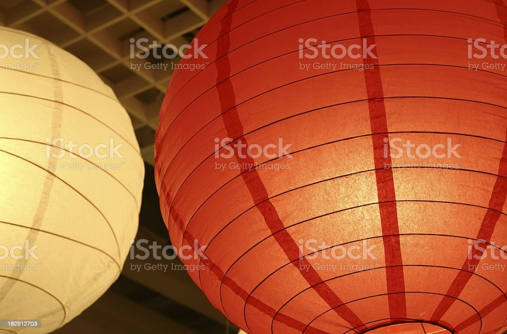 One white and one red paper lampshade royalty-free stock photo