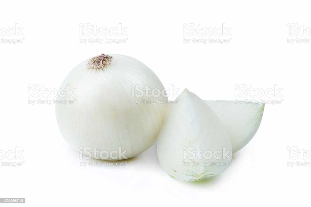 One White Onion and Sliced Pieces stock photo