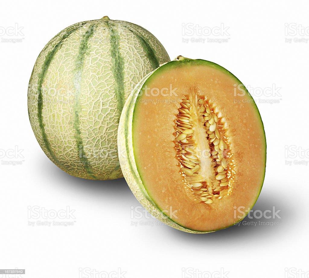 One whole cantaloupe and one half stock photo