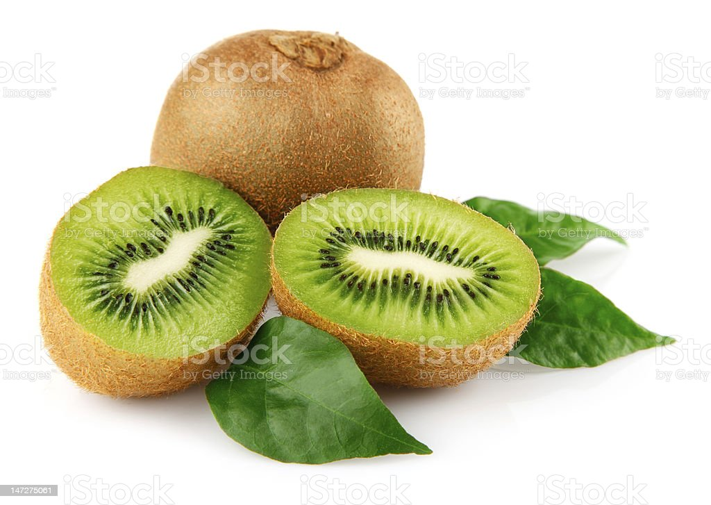 One whole kiwi and one fresh sliced kiwi with green leaves stock photo