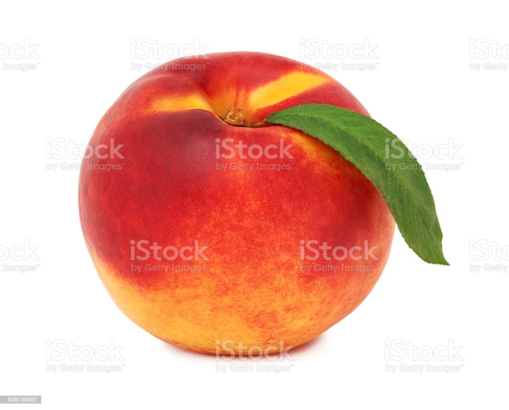 One whole ripe nectarine with green leaf (isolated) stock photo