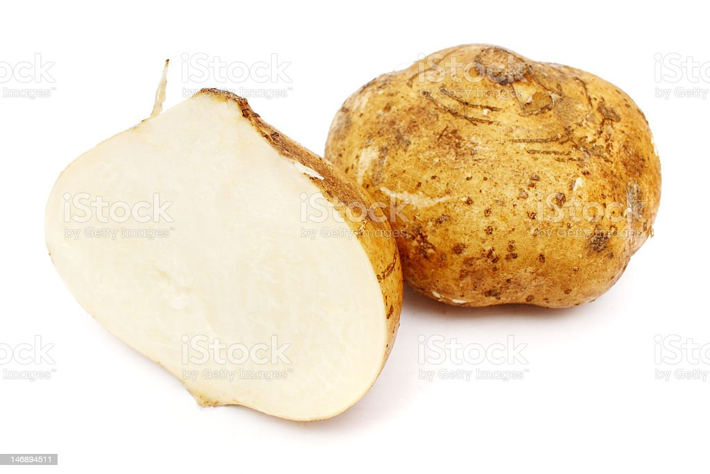 One whole yam bean and one cut in half stock photo