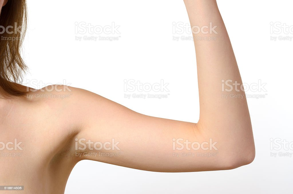 One woman bare shoulder and arm bent at the elbow stock photo