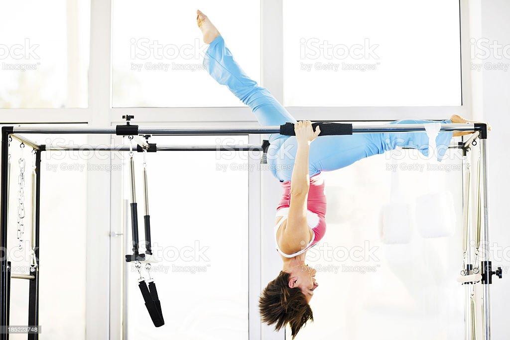One woman exercising gymnastics Pilates. stock photo