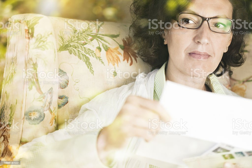 One woman reading a letter. stock photo