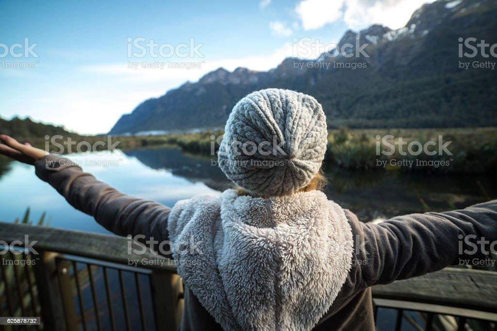 One woman relaxing by the lake stock photo