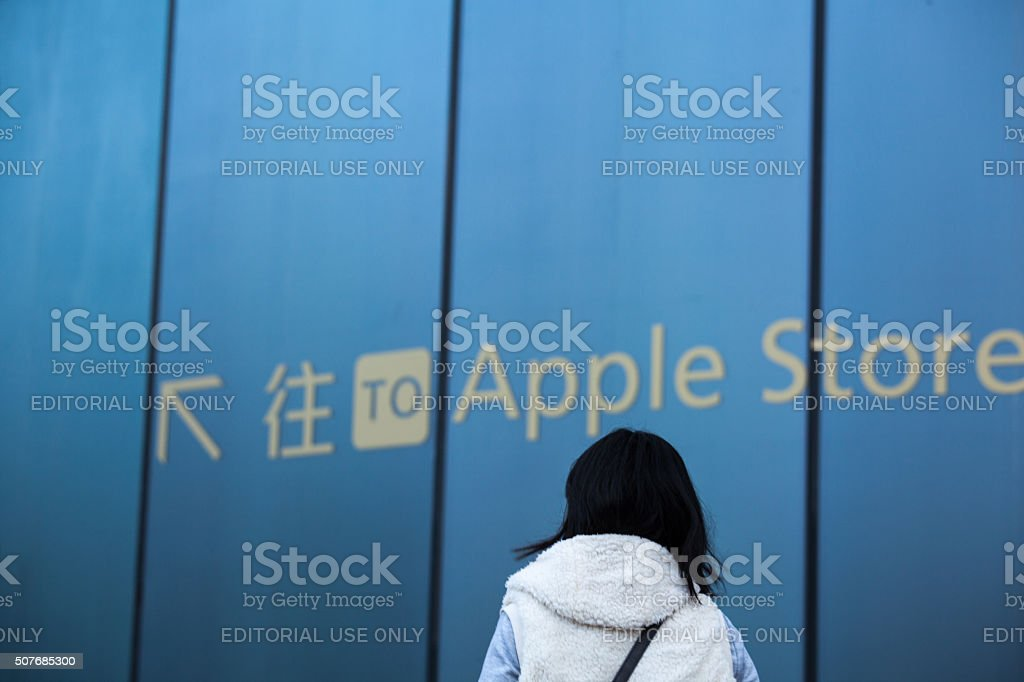 One woman watch road sign of apple store stock photo