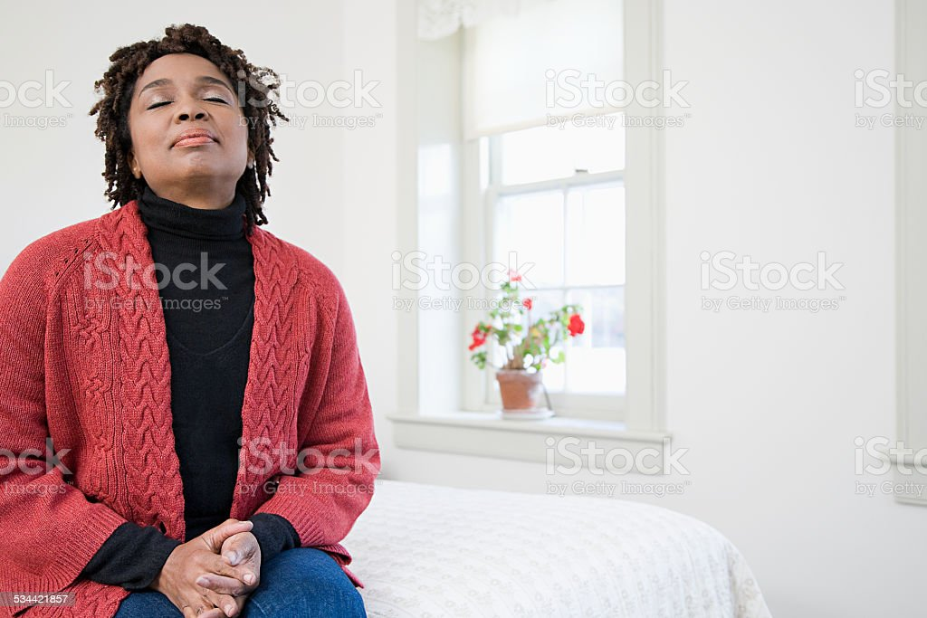 One woman with her eyes closed stock photo