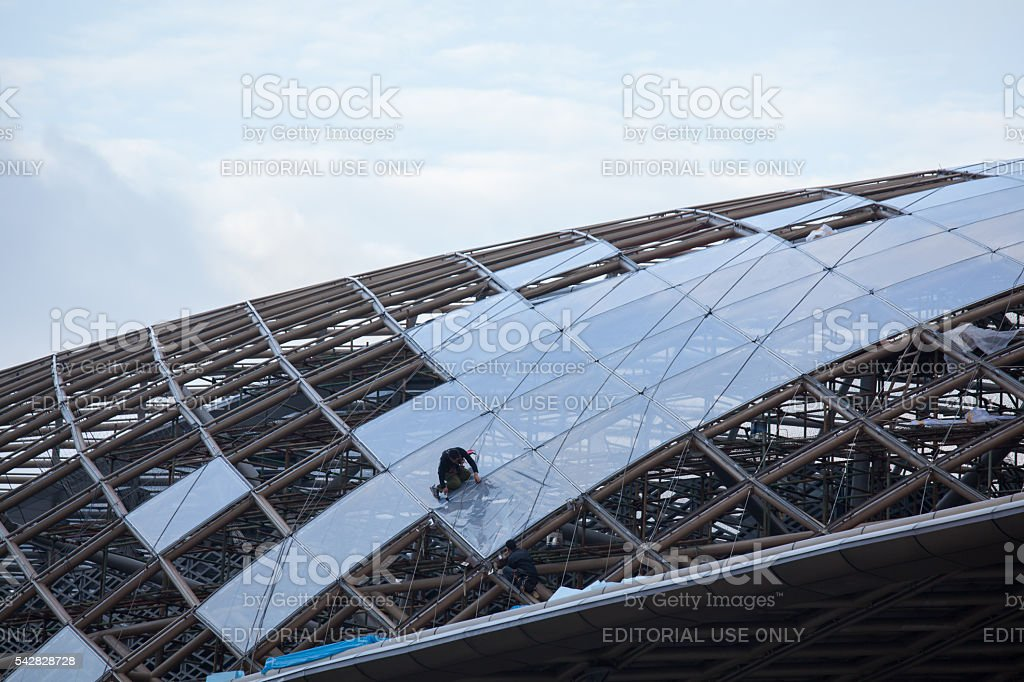 One worker on top of modern building. stock photo