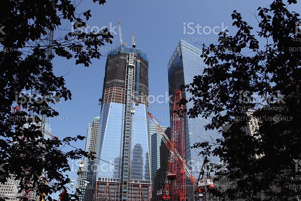 One World Trade Center construction site and trees stock photo