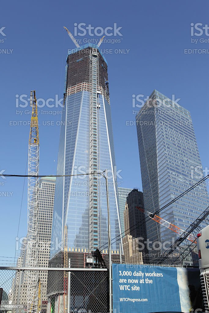 One World Trade Center NYC and daily workers sign stock photo