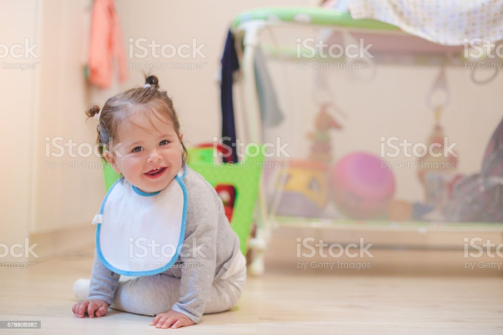 one year old baby sitting in a nursery room stock photo