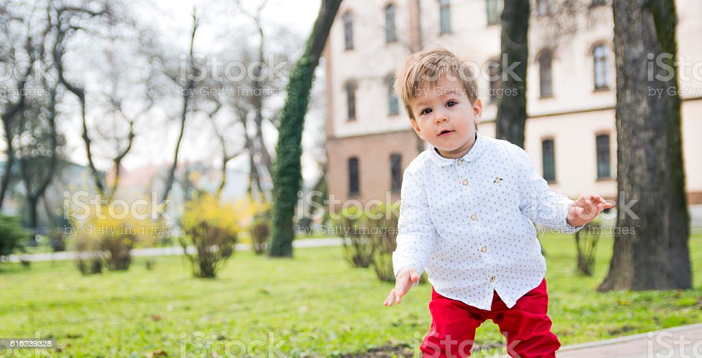 One year old boy looking at camera stock photo