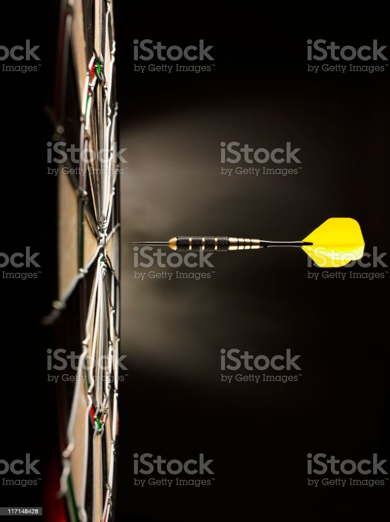 One Yellow Dart on Target stock photo