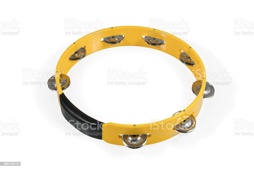 One yellow tambourine isolated stock photo