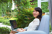 one young asian business woman working with laptop