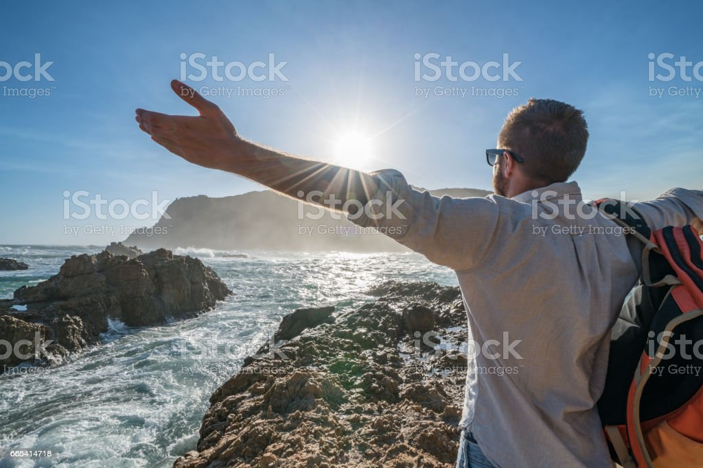 One young man embracing nature-travel concept stock photo