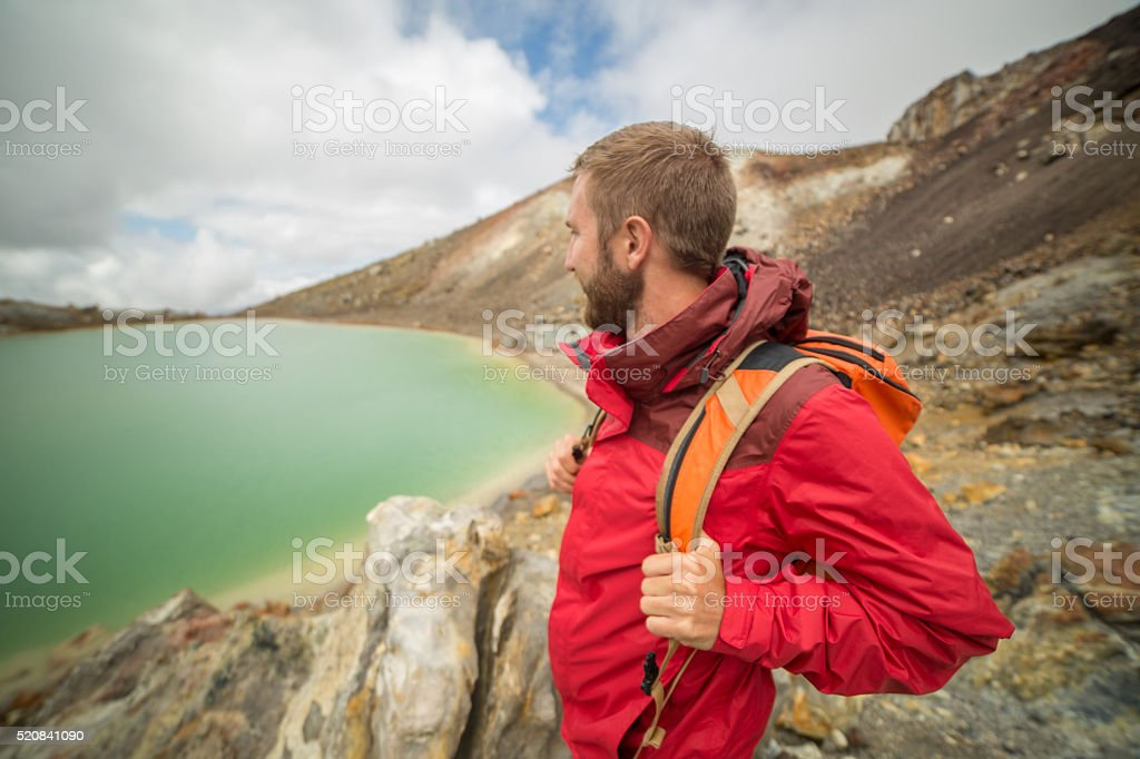 One young man hiking by the lake stock photo