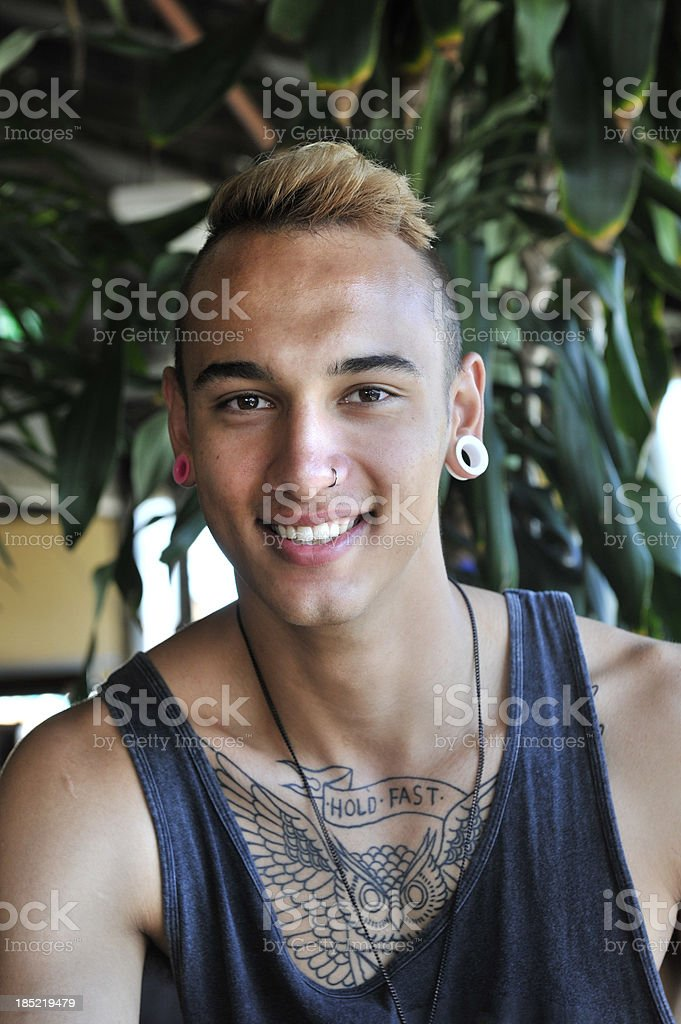 One young man smiling at the camera stock photo