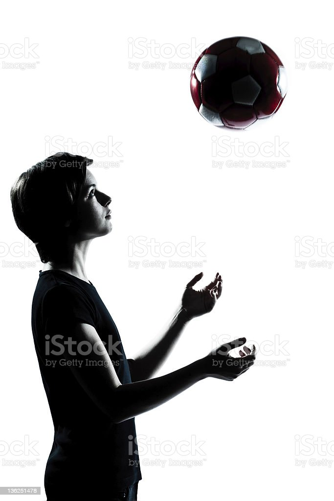 one young teenager boy girl silhouette tossing soccer football royalty-free stock photo