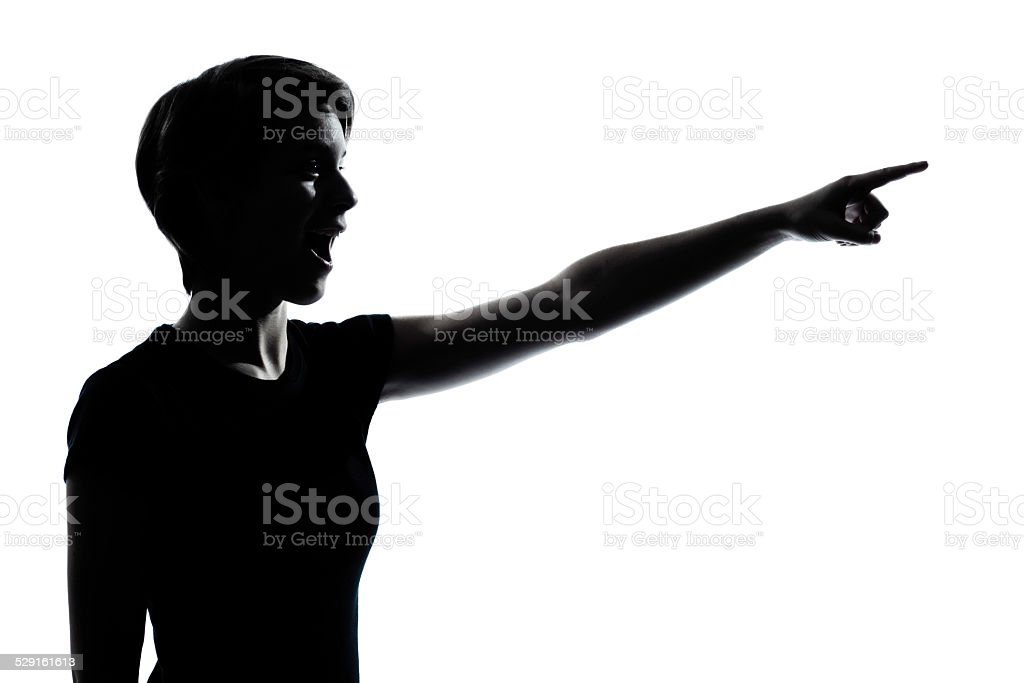 one young teenager girl pointing surprised silhouette stock photo
