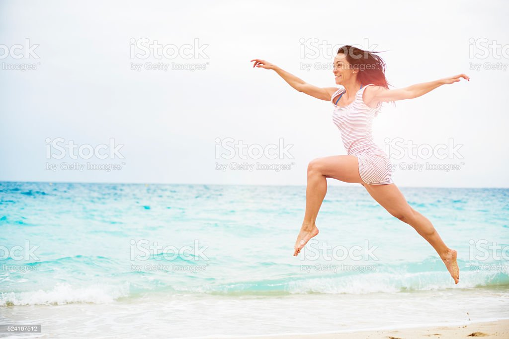 One young woman Feeling free at the beach stock photo