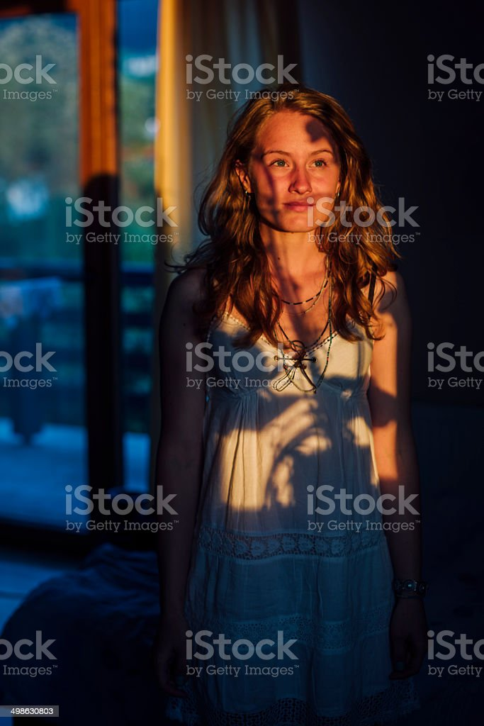 one young woman in nightgawn standing still stock photo