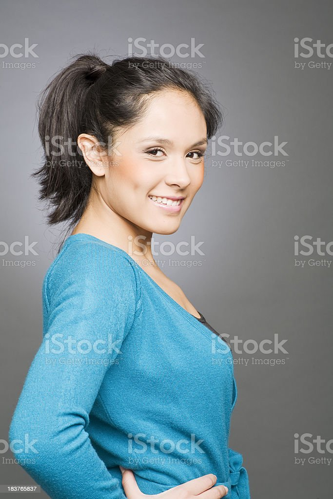 One young woman in profile with blue sweater. royalty-free stock photo