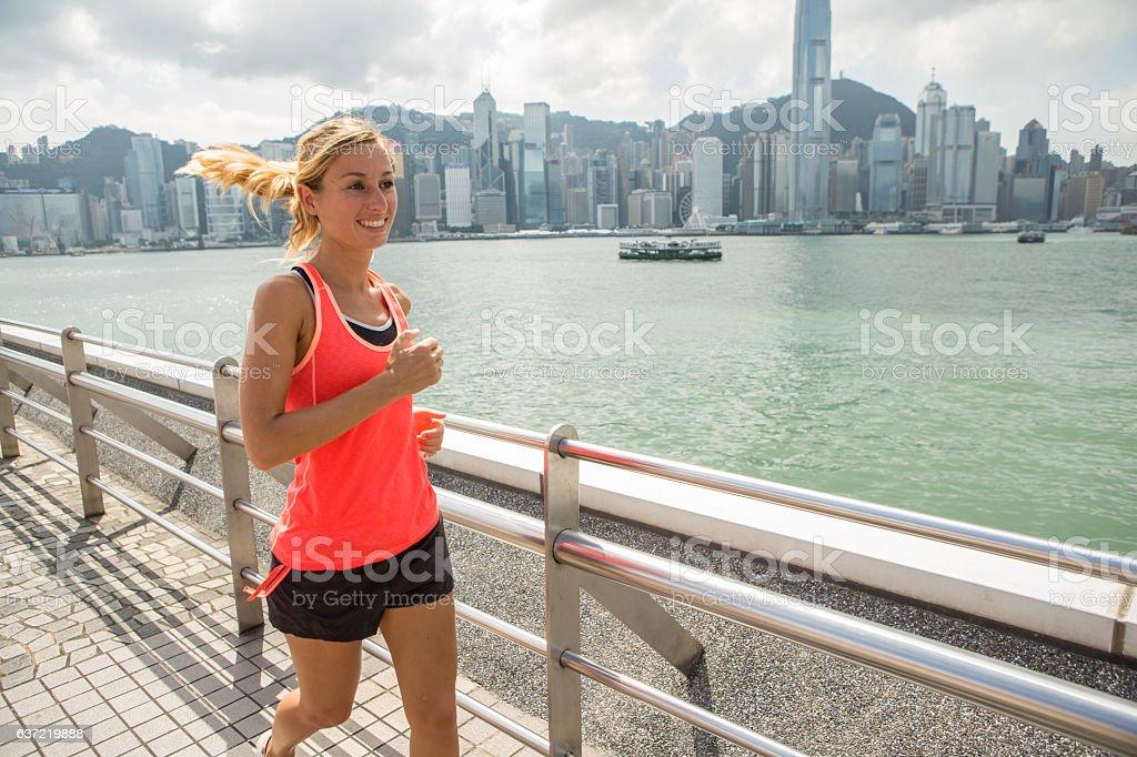One young woman joggin in Hong Kong stock photo