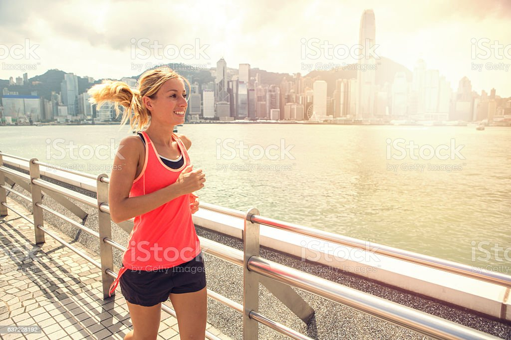 One young woman joggin in Hong Kong stock photo