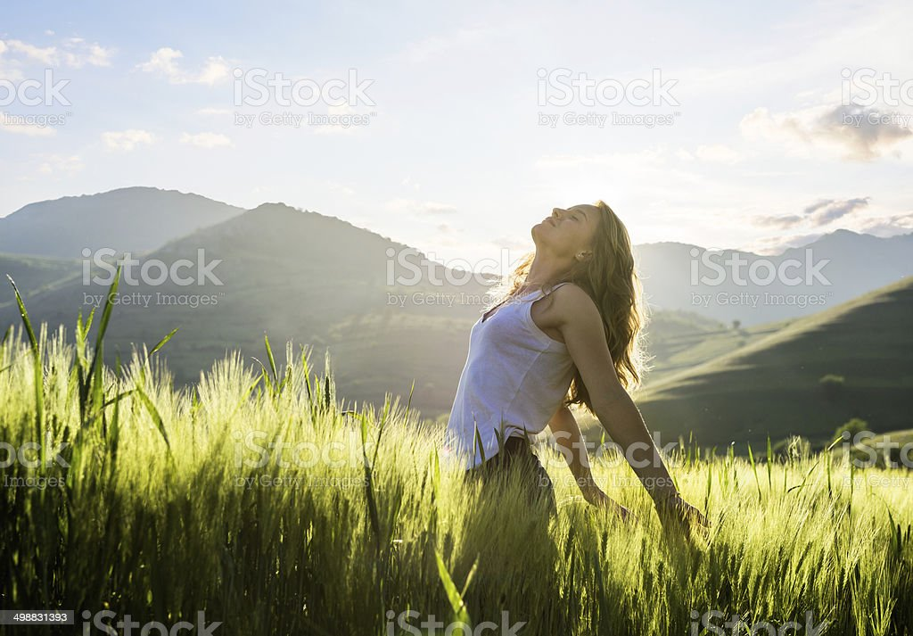 One young woman relaxing outoors stock photo