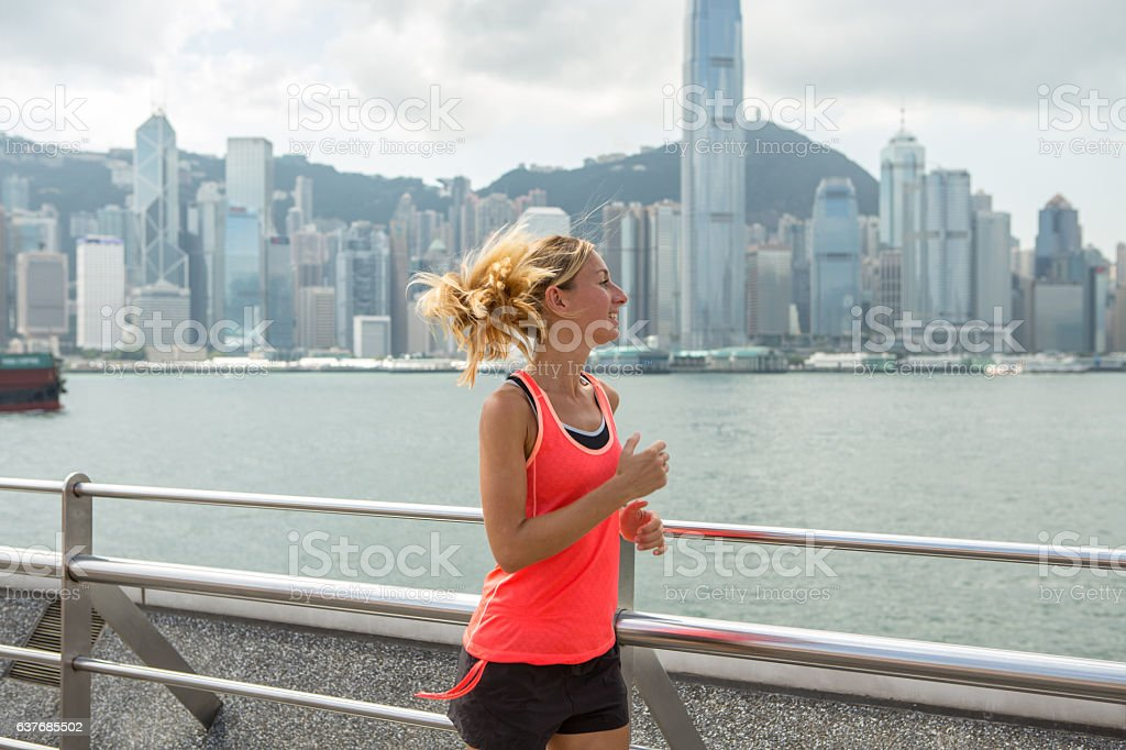 One young woman running in Hong Kong stock photo