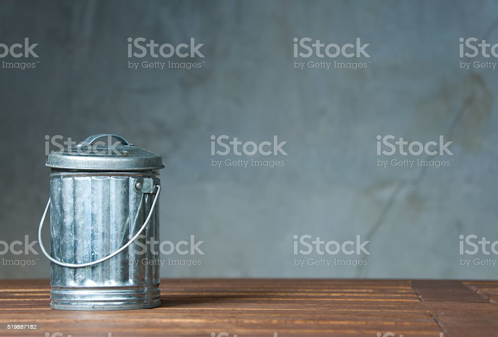 One zinc bin on the wooden table stock photo