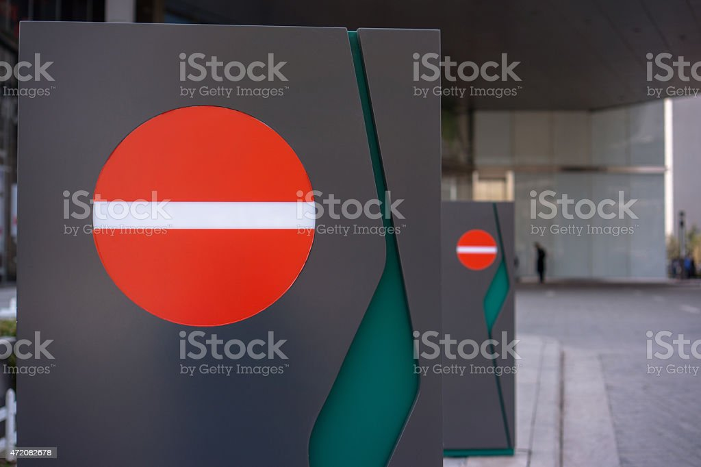 one-way sign at roadside stock photo
