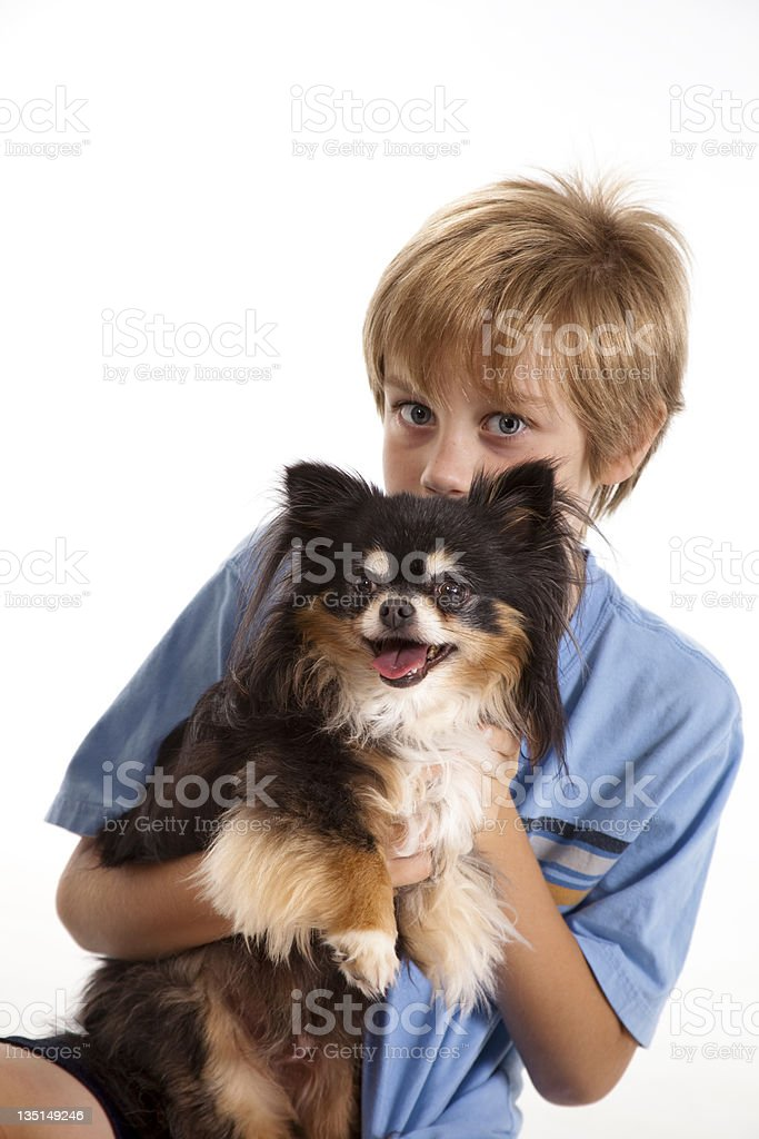 OneYoung boy with their puppy portrait royalty-free stock photo