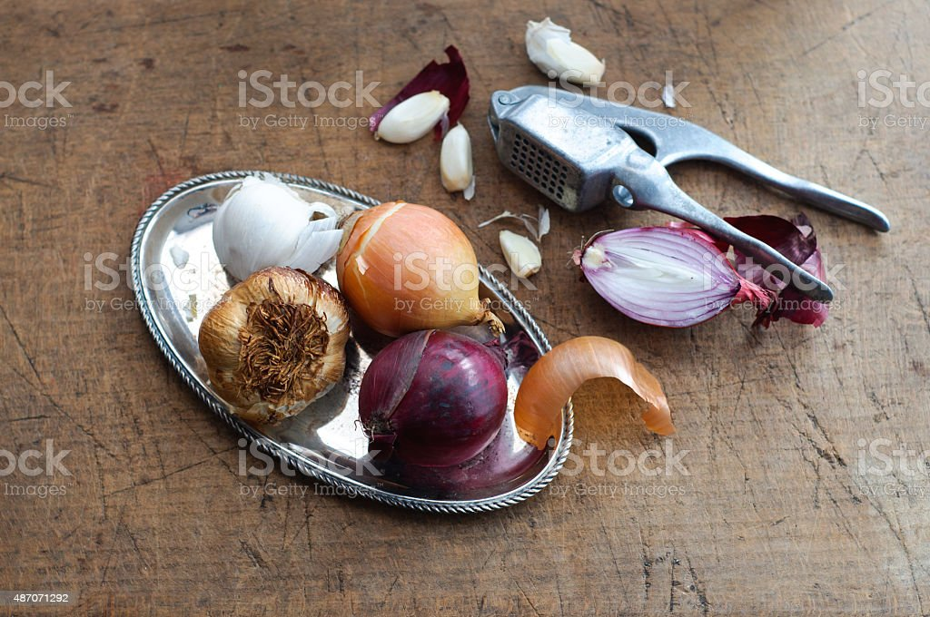 Onion and Garlic on Silver Tray stock photo