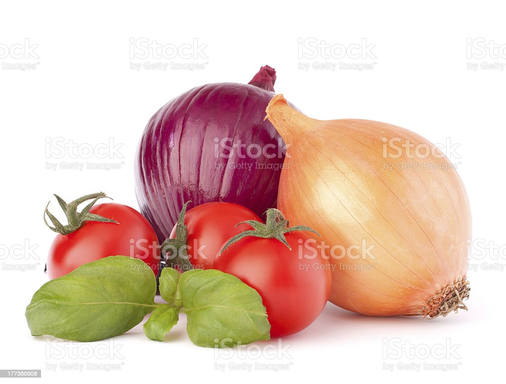 Onion, cherry tomato and basil herb leaves still life stock photo